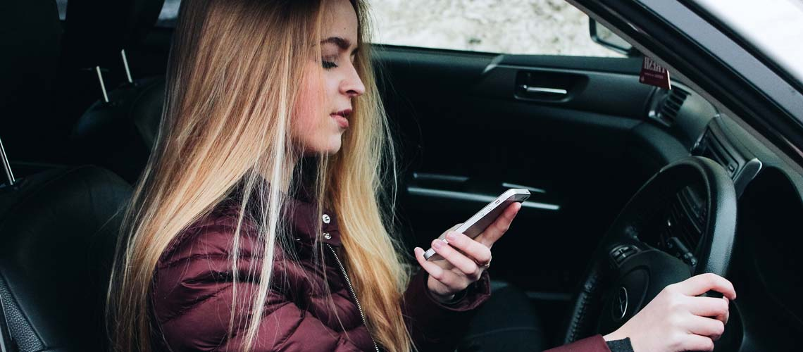 Woman driving using mobile phone