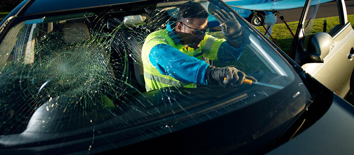 NRMA auto glass technician removing a windscreen