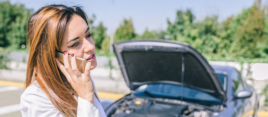Woman with flat car battery