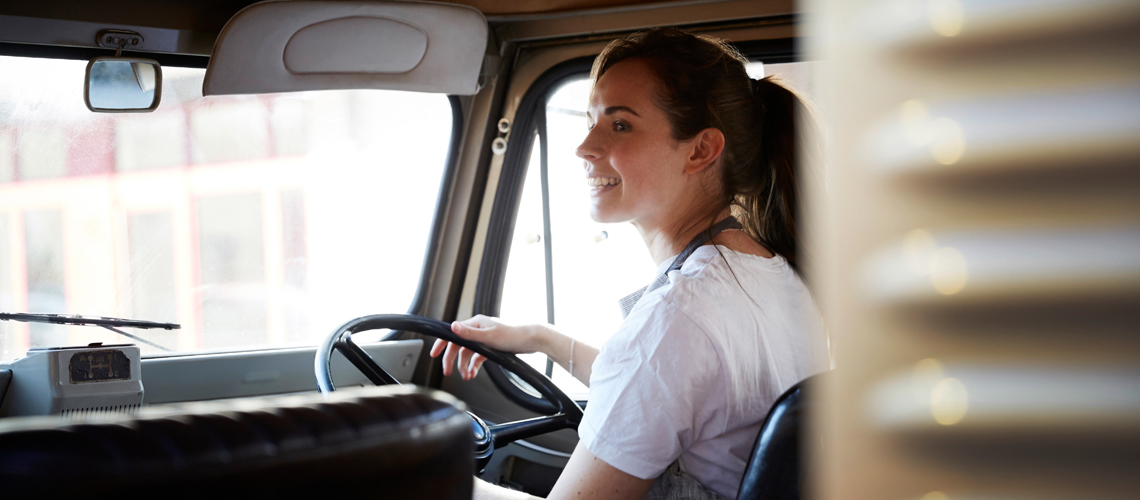 Woman driving business vehicle