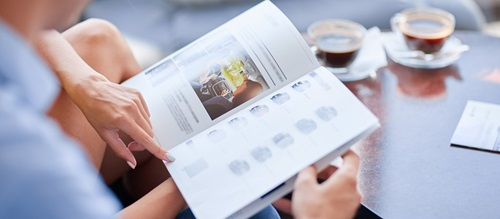 Couple pointing at car brochure
