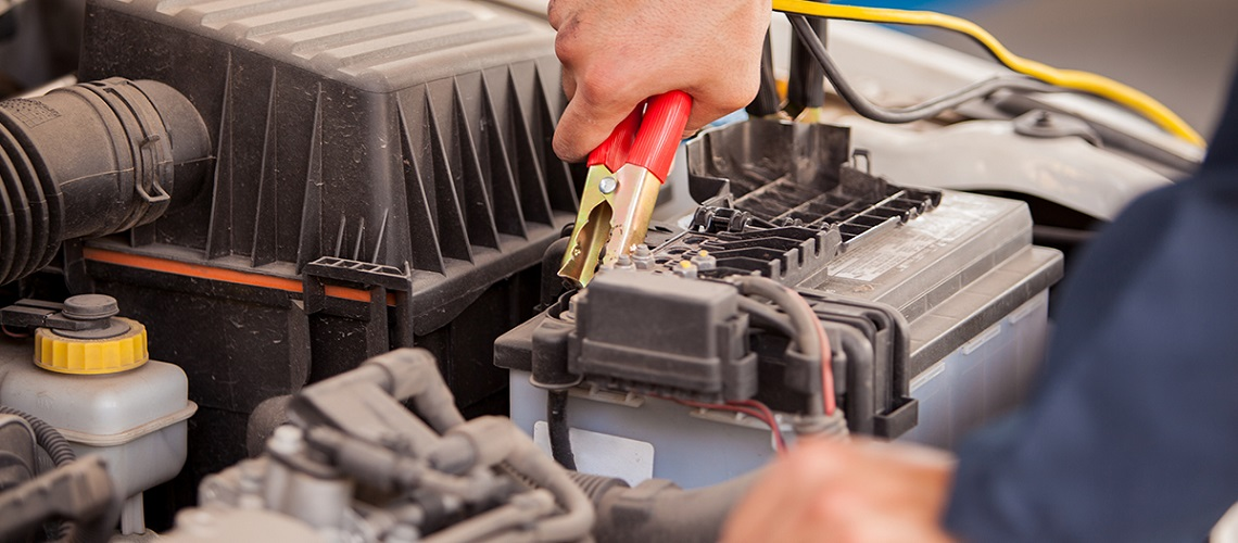 Mechanic checking a car battery