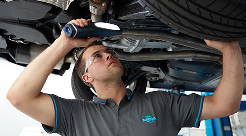 NRMA mechanic servicing a car