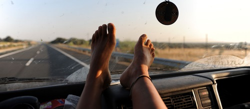 Feet on dashboard dangers