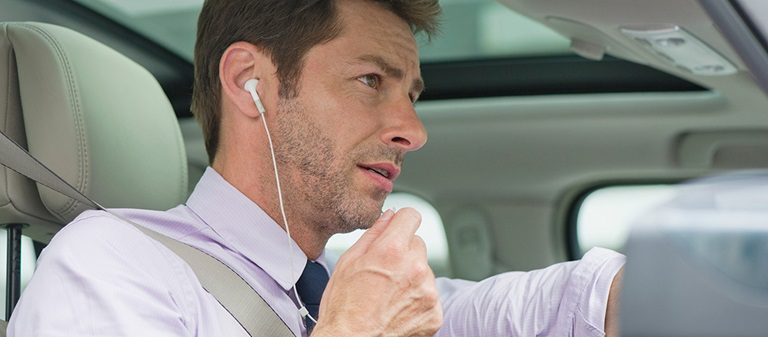 Is it illegal to drive with headphones or earphones? NRMA
