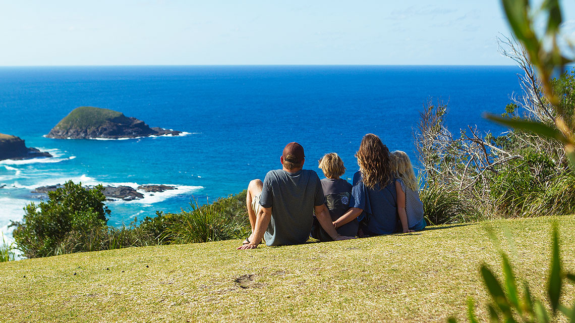 Family looking at view Horseshoe Bay Holiday Park NSW my nrma local guides