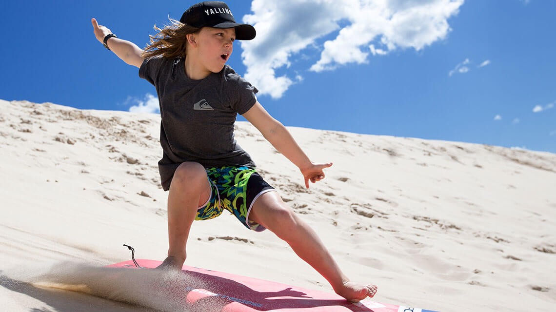 Child sandboarding Myall Shores Holiday Park my nrma local guides