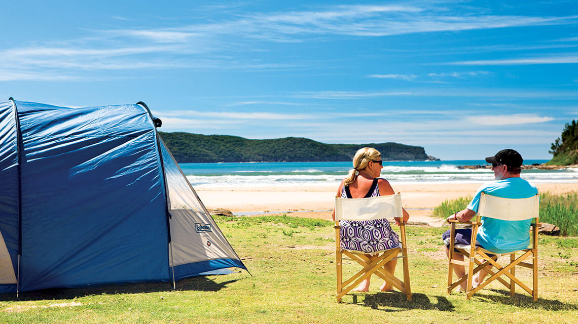 couple relaxing near tent NRMA Ocean Beach Holiday Resort NSW my nrma local guides