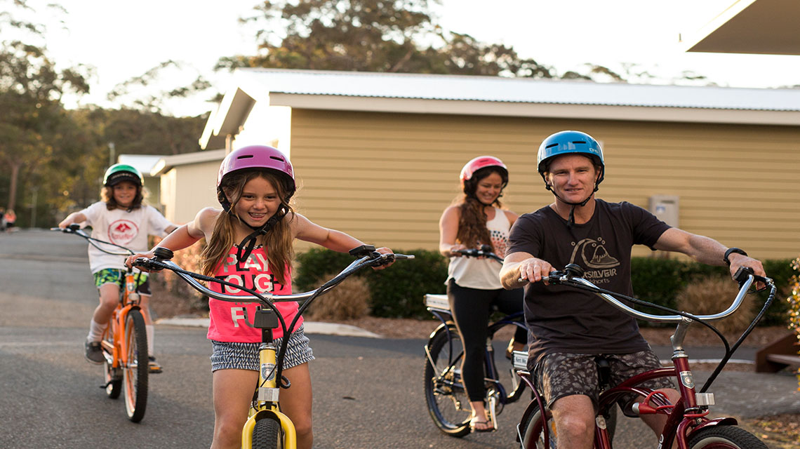 family bike riding NRMA Ocean Beach Holiday Resort NSW my nrma local guides