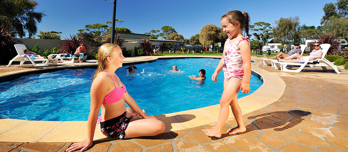 children relaxing near pool Eastern Beach Holiday Park Victoria my nrma local guides