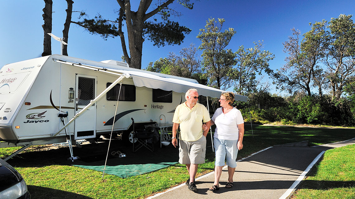 Old Couple Walking Eastern Beach Holiday Park NRMA Parks and Resorts VIC