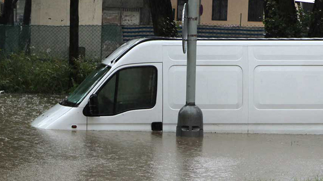 flood hit vehicle van in water
