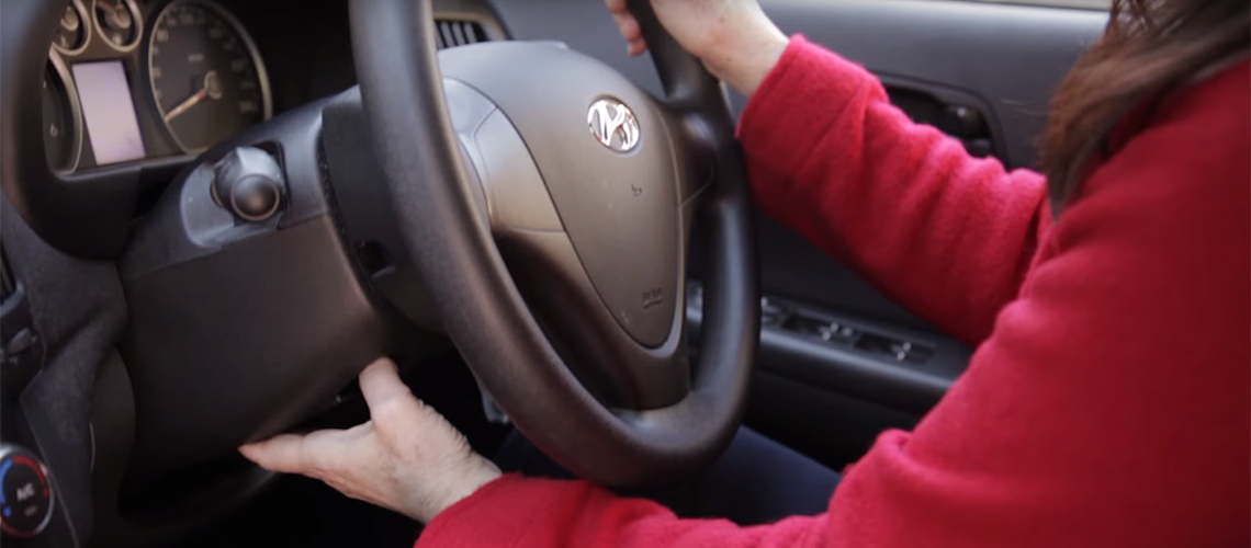 Optimal driving position behind steering wheel