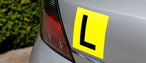 L plate on rear of car