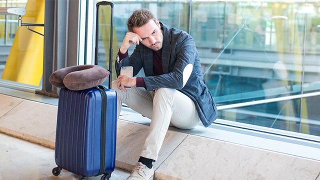 Man waiting with luggage